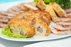 Tasty meat rolls and sliced bacon on white plate Royalty Free Stock Image