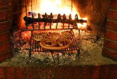 Tasty meat with sausage and chop in the fireplace with the ember Stock Photography