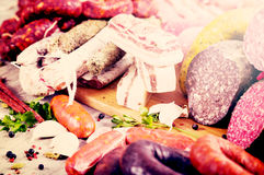 Tasty meat and sausage products. A bunch of meat and sausages of various kinds Royalty Free Stock Image