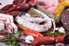 Tasty meat and sausage products. Pile of delicious sausages of various kinds Royalty Free Stock Image