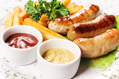 Tasty meat sausages with vegetables Stock Photography