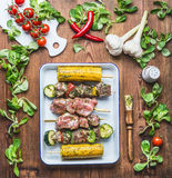 Tasty meat, vegetables and corn skewers in herbs marinate with fresh seasoning and Basting Brush for grill on rustic kitchen table. Background , top view Stock Images