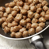Tasty meatballs beeing prepared in a frying pan Royalty Free Stock Photography