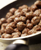 Tasty meatballs beeing prepared in a frying pan Royalty Free Stock Photo