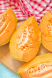 Tasty melon pieces on rustic table Stock Photo