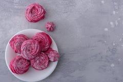 Tasty meringues cookies on plate Royalty Free Stock Photos