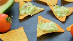 Tasty mexican guacamole on nachos stock footage
