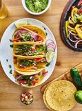 Tasty mexican tacos with beef fajita filling served with salsa and guacamole in flat lay composition stock photo