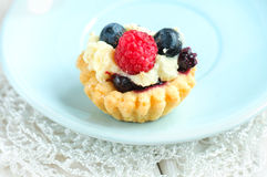 Tasty mini cake with fresh raspberries and blueberries Stock Photo