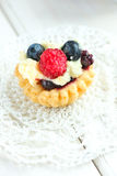 Tasty mini cake with fresh raspberries and blueberries Stock Photos