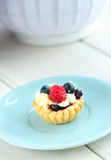Tasty mini cake with fresh raspberries and blueberries Royalty Free Stock Photo