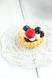 Tasty mini cake with fresh raspberries and blueberries Royalty Free Stock Image