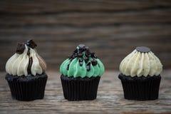 Tasty mini cupcakes on a vintage background royalty free stock photo