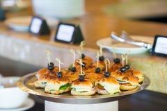 Tasty mini hamburgers sliders on plate Royalty Free Stock Photography