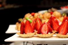 Tasty mini tarts with strawberry and vanilla cream Royalty Free Stock Image