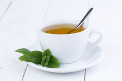 Tasty mint tea on wooden table. Royalty Free Stock Photography