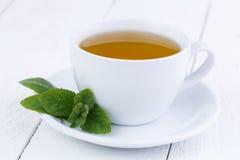 Tasty mint tea on wooden table. Stock Photo