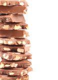 Tasty morsel of milk chocolate with nuts. Stock Image