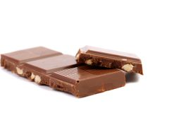 Tasty morsel of milk chocolate with nuts. Stock Images