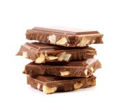 Tasty morsel of milk chocolate with nuts. Stock Photography