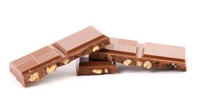 Tasty morsel of milk chocolate with nuts. Royalty Free Stock Photo
