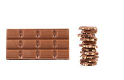 Tasty morsel of milk chocolate with nuts. Stock Photo