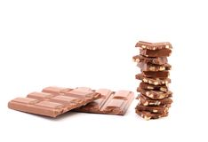 Tasty morsel of milk chocolate with nuts. Stock Photos
