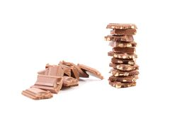 Tasty morsel of milk chocolate with nuts. Royalty Free Stock Images