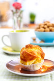 Tasty muffin on breakfast table Stock Photos