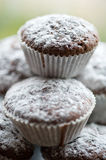 Tasty muffin cakes sprinkled with powdered sugar homemade Stock Photos