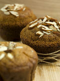 Tasty muffins with almonds crust Stock Images