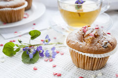 Tasty muffins with sugar hearts and cup of green tea Royalty Free Stock Photography