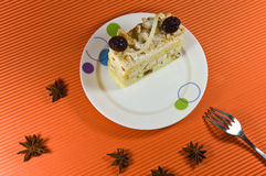 Tasty multy layer cake with white chocolate. Tasty and fresh multy layer cake with white chocolate and berry decorations. Cake is placed on the white plate Stock Photos