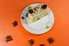 Tasty multy layer cake with white chocolate. Tasty and fresh multy layer cake with white chocolate and berry decorations. Cake is placed on the white plate upon Royalty Free Stock Photos