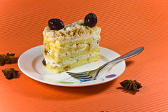 Tasty multy layer cake with white chocolate. Tasty and fresh multy layer cake with white chocolate and berry decorations. Cake is placed on the white plate Stock Image