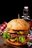 Tasty mushroom burger with salad trimmings. And a thick juicy beef patty on a crusty roll served on a spatula with copy space above Stock Photo