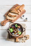 Tasty mussels with garlic sauce served with bread Royalty Free Stock Photos