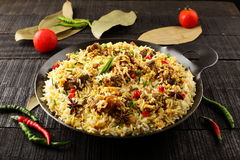Tasty Mutton biriyani in cast iron cookware Royalty Free Stock Photography