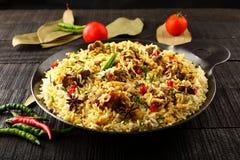 Tasty Mutton biriyani in cast iron cookware Stock Image