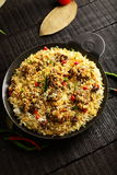 Tasty Mutton pilaf in cast iron cookware Stock Photos