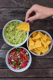 Tasty nachos and dips Royalty Free Stock Photos