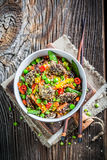 Tasty noodles with fresh vegetables and beef in sesame Royalty Free Stock Images