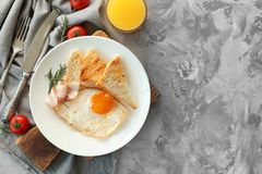 Tasty nutrient breakfast with fried. Egg on table Stock Images