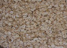 Tasty nutritious oat flakes background pattern, top view Stock Image