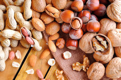 Tasty nuts on a wooden table in field top view Royalty Free Stock Photography