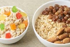 Oatmeal with almonds and raisins. Porridge with dried fruits. Tasty oatmeal with almonds and raisins. Porridge with dried fruits Royalty Free Stock Photo