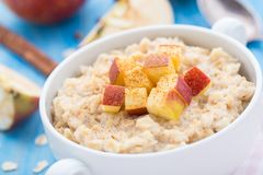 Tasty oatmeal with apples and cinnamon Stock Photo