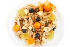 Tasty oatmeal porridge or muesli with berries. On white Royalty Free Stock Photos