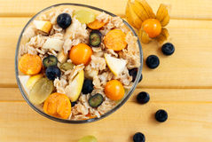 Tasty oatmeal porridge or muesli with berries Stock Photography