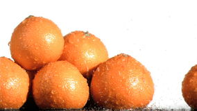 Tasty oranges in super slow motion being soaked stock video
